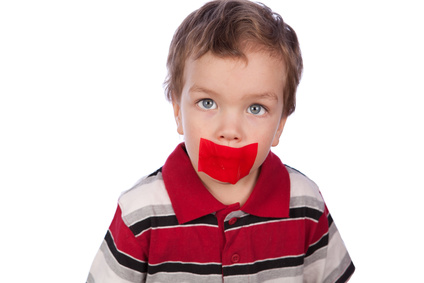 The boy's mouth by red tape